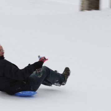 Sledding with a friend.
