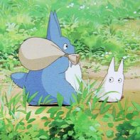 Blue Totoro and White Totoro in the animated film.