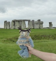 Getting a helping hand from a friend to pose for a Stonhenge long shot.