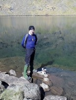 Seb and Bananas at Coniston Water. Not sure if Bananas is roped on for safety or to stop him running into mischief.