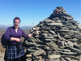 "Seb says, ""Here's Jo and Bananas Bunny officially entering the Wainwright Climber's club at the 803 metre summit of The Old Man of Coniston, the 1st of two Wainwright summits of the day! Well done you crazy mountaineers!"""