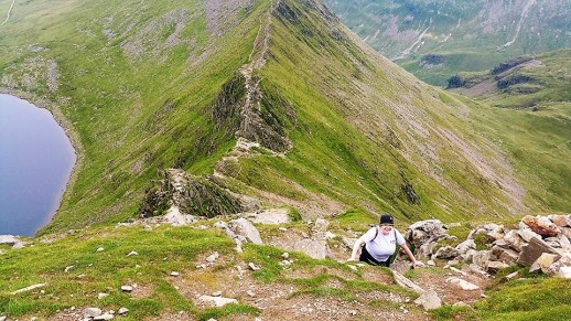 Lisa summitting Helvellyn for the second time that day, after braving the bowel-loosening Striding Edge.