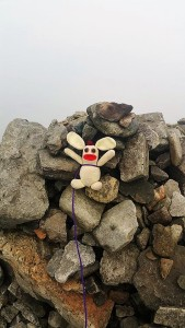 After puffing and panting his way up England's 3rd tallest mountain, Bunny was exhausted, and took a rest on the summit cairn... The low cloud blocked out the horrific precipice of death about half a metre behind him.