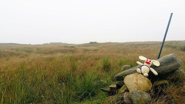 The summit cairn of Kinder Scout is disappointingly unimpressive, and surprisingly difficult to find.
