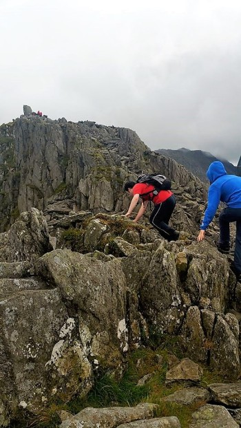 David looks down at the precipice which separates The North Tower from Tryfan summit.