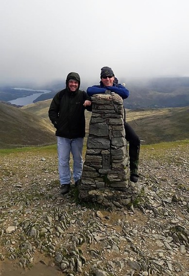 Seb and Stuart at a trig point.