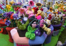 A close up of some of the knitted flowers.